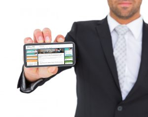 10779139-businessman-showing-his-smartphone1