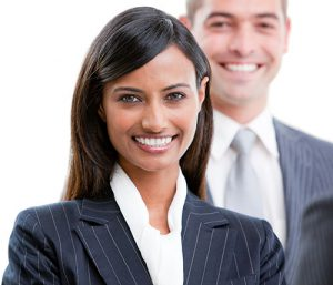 Smiling young business people standing in a row against a white background