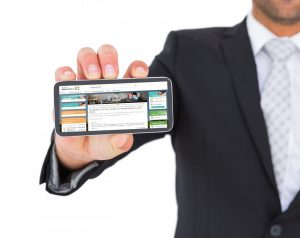 10779139-businessman-showing-his-smartphone2